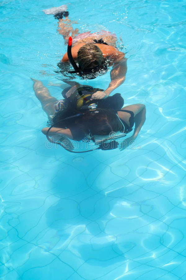 Girl learning to dive stock image