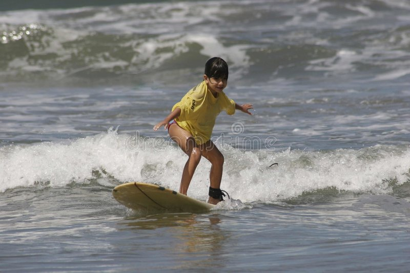 Girl Learning to Surf stock photos
