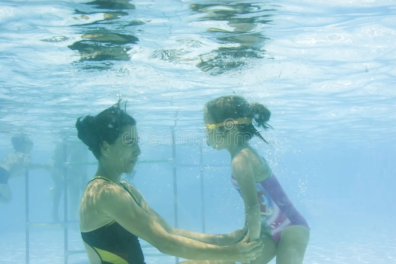 Download Girl Learning To Swim With Mom Stock Photo - Image: 11378818