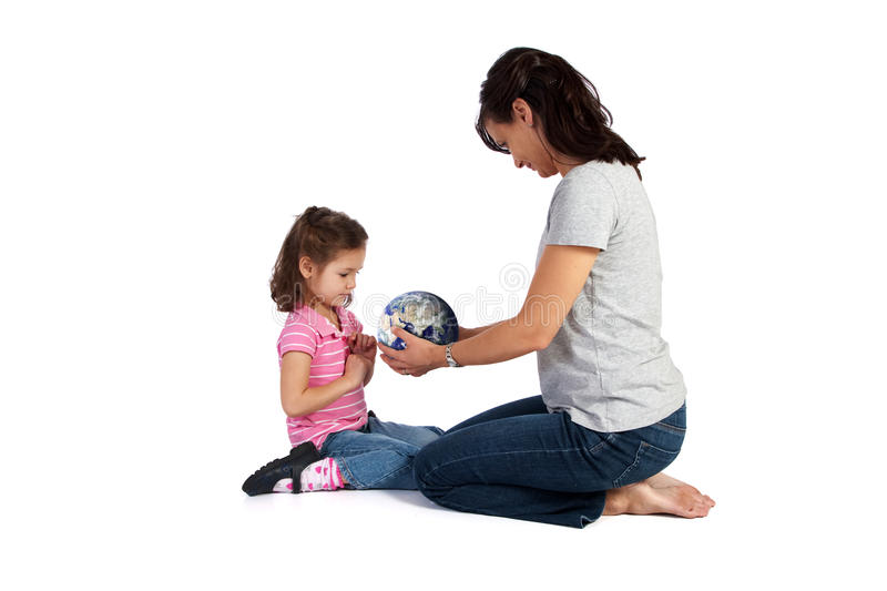 Girl learning about world from teacher stock photos