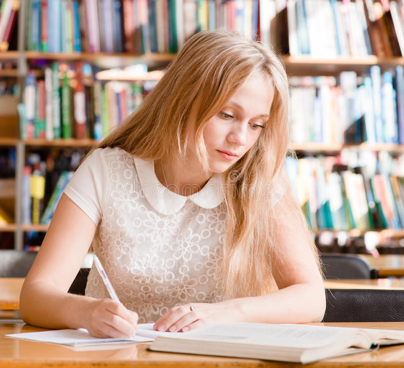 Girl learns lessons before the exam.  royalty free stock photos