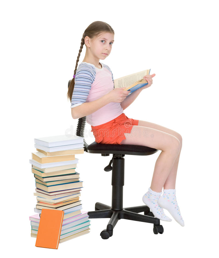 Download Girl Learns Lessons Near Big Pile Of Books Stock Photo - Image: 12580478