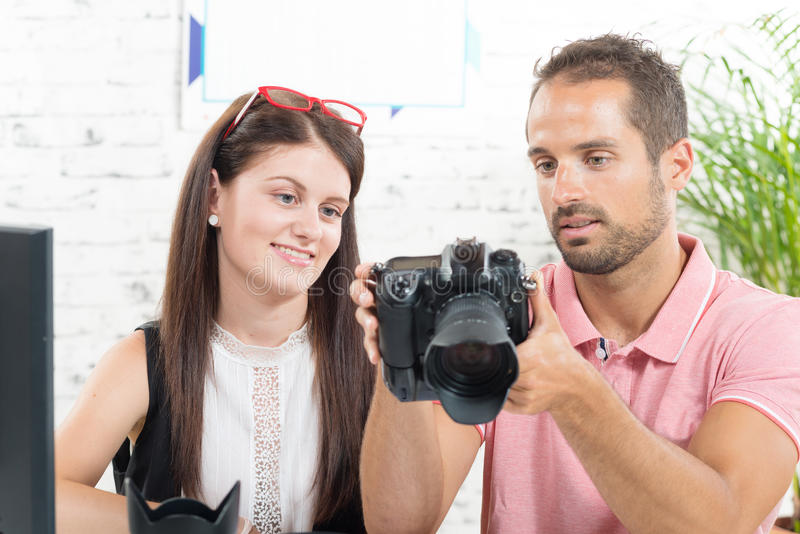 A girl learns photography royalty free stock photography