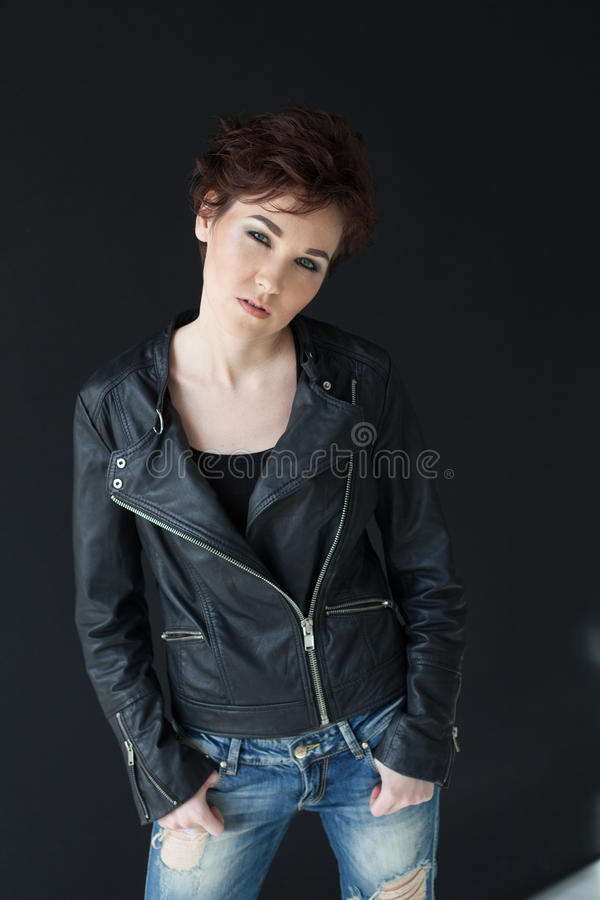 Girl in leather jacket short hairstyle royalty free stock photos