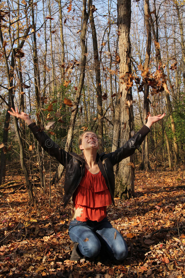 Download Girl with leaves stock image. Image of smiling, confident - 27873077