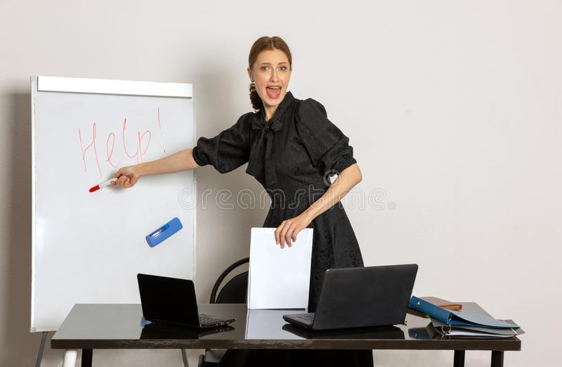 Girl lecturer in the office asks for help royalty free stock photography