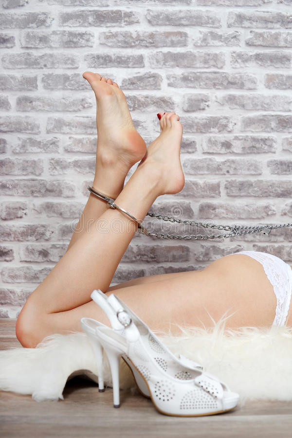 Girl in leg irons stock images