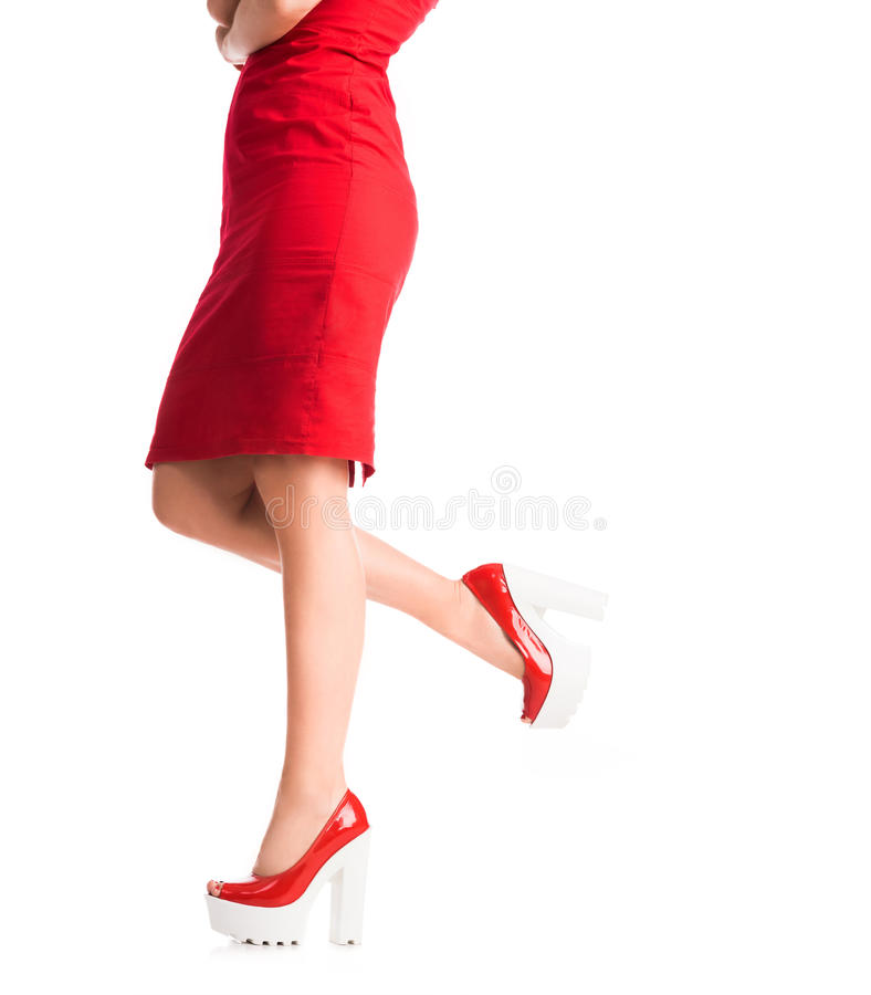 Girl legs on heels. With one leg lifted royalty free stock photo
