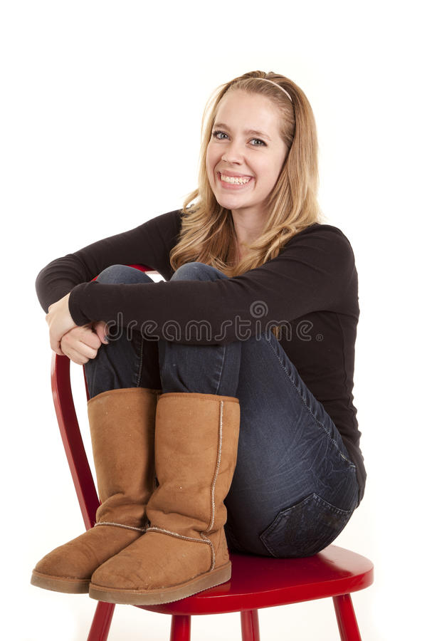 Girl legs up red chair stock image