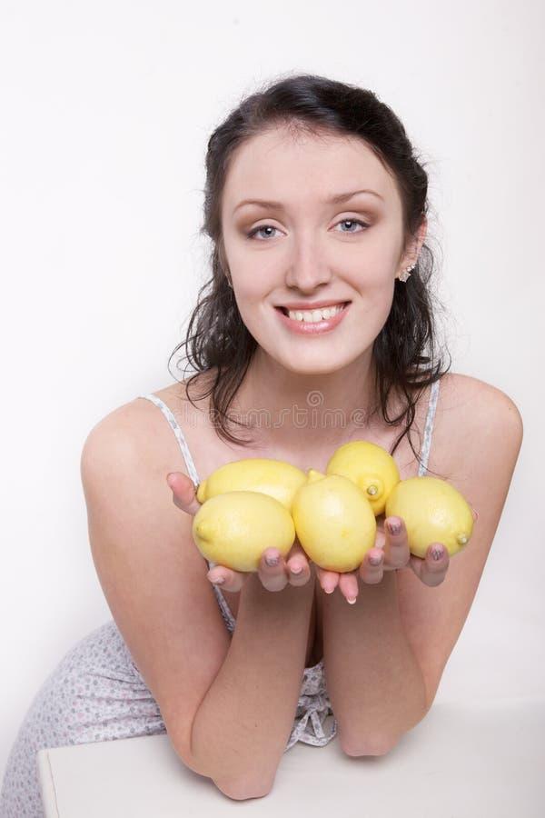 Girl with lemon royalty free stock photography