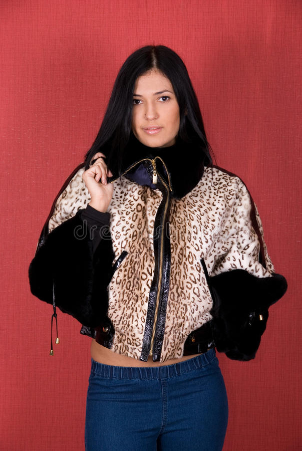Girl at leopard jacket stock images