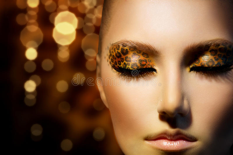 Girl With Leopard Makeup Stock Photo