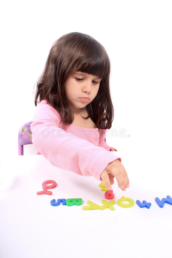 Girl and letters stock photography