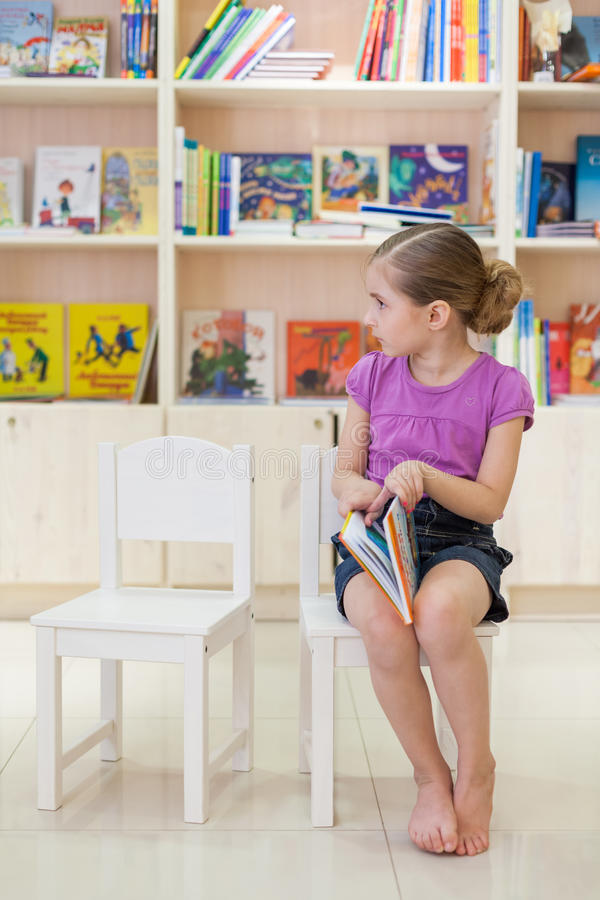 Download The girl in the library stock photo. Image of happy, school - 32482250