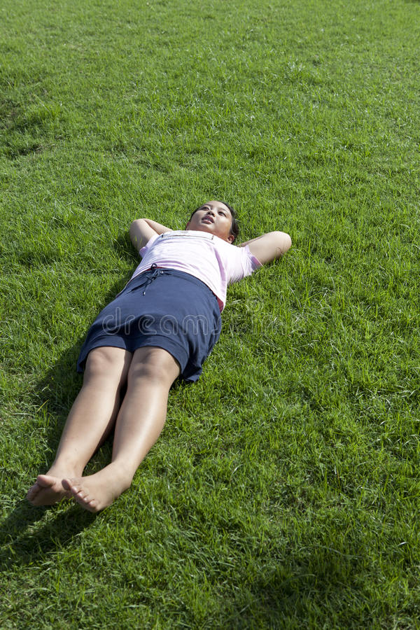 Download Girl Lied On Green Grass Field Wiht Morning Light Stock Image - Image: 28313859