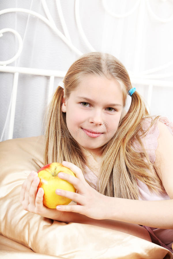 Download Girl lies in a bed stock photo. Image of girls, human - 18655330