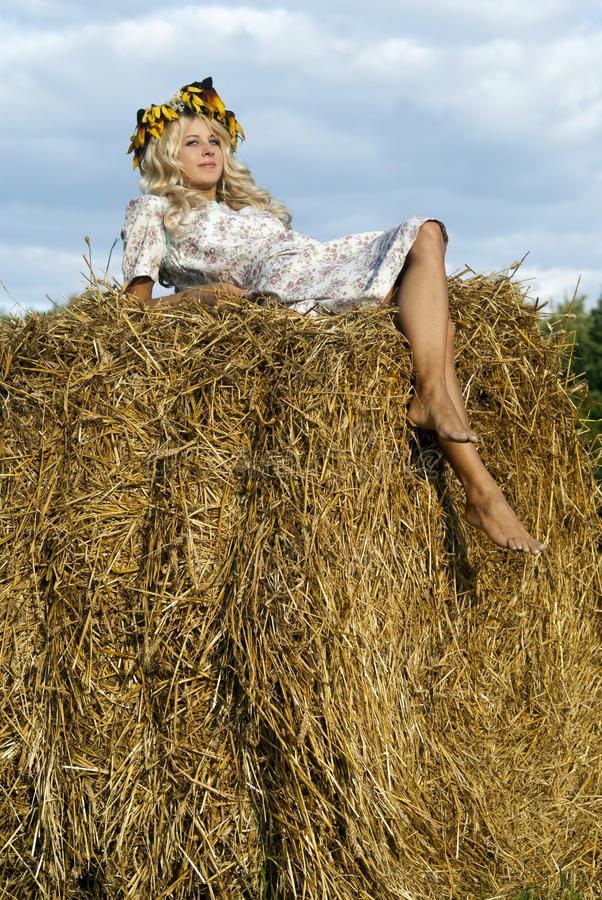 Girl lies on the haystack royalty free stock photos