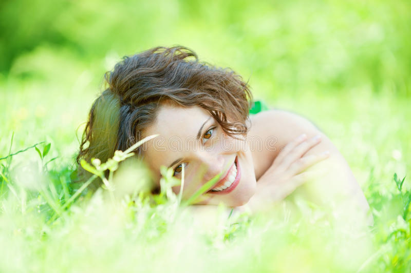 Girl lies on lawn royalty free stock photo