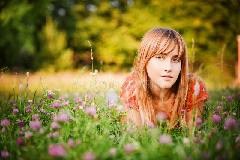 Girl Lies On Lawn Royalty Free Stock Photos