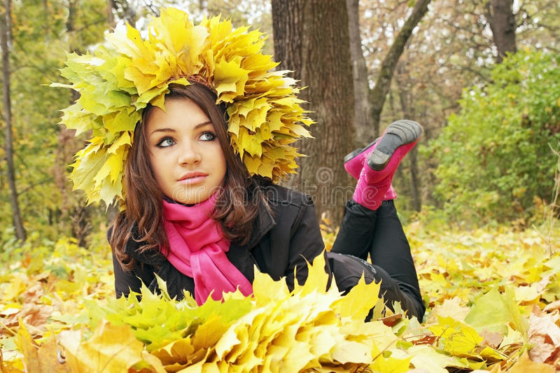 Girl lies on leaves royalty free stock photography