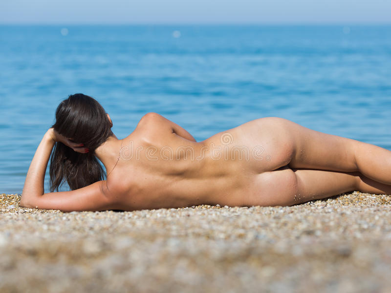 Download Girl Lies On Seashore, Having Propped Up The Head A Hand Stock Photo - Image: 83706580