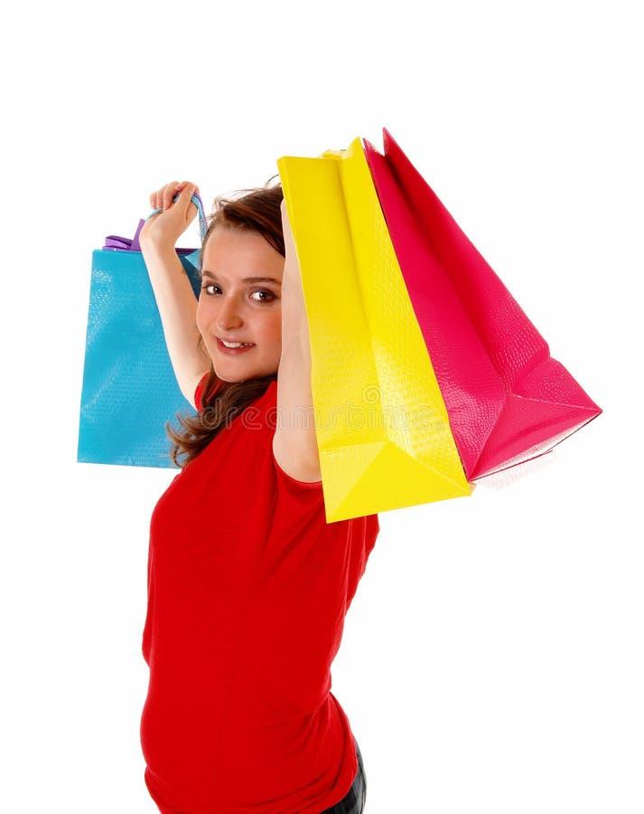 Girl lifting shopping bag's. royalty free stock photography