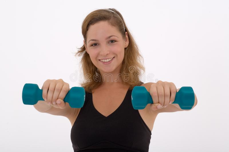 Girl lifting a weight royalty free stock photography