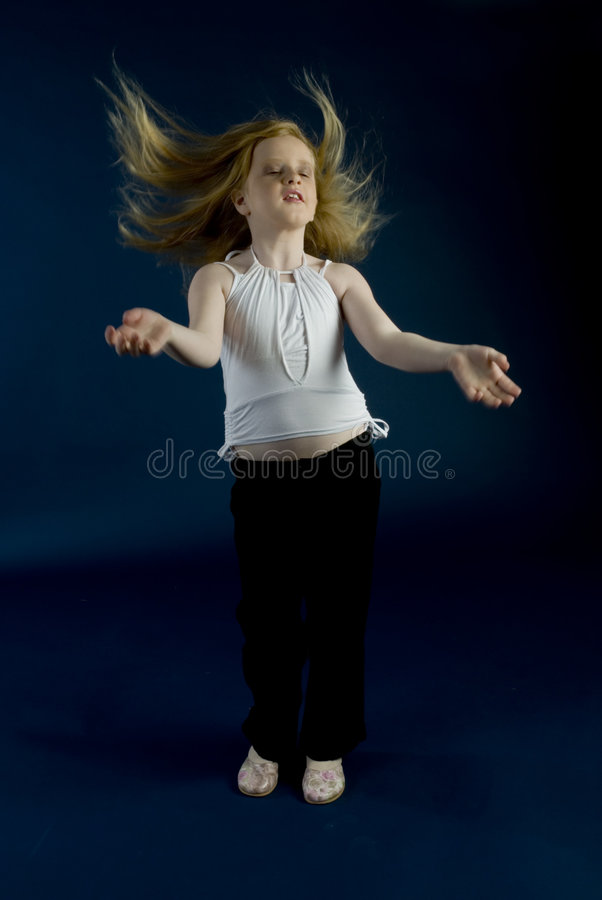 Girl like a photomodel. Girl is acting like a fotomodel in the studio royalty free stock photo