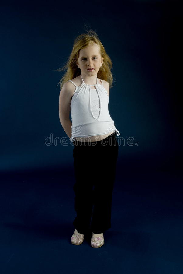 Girl like a photomodel. Girl is acting like a fotomodel in the studio royalty free stock image