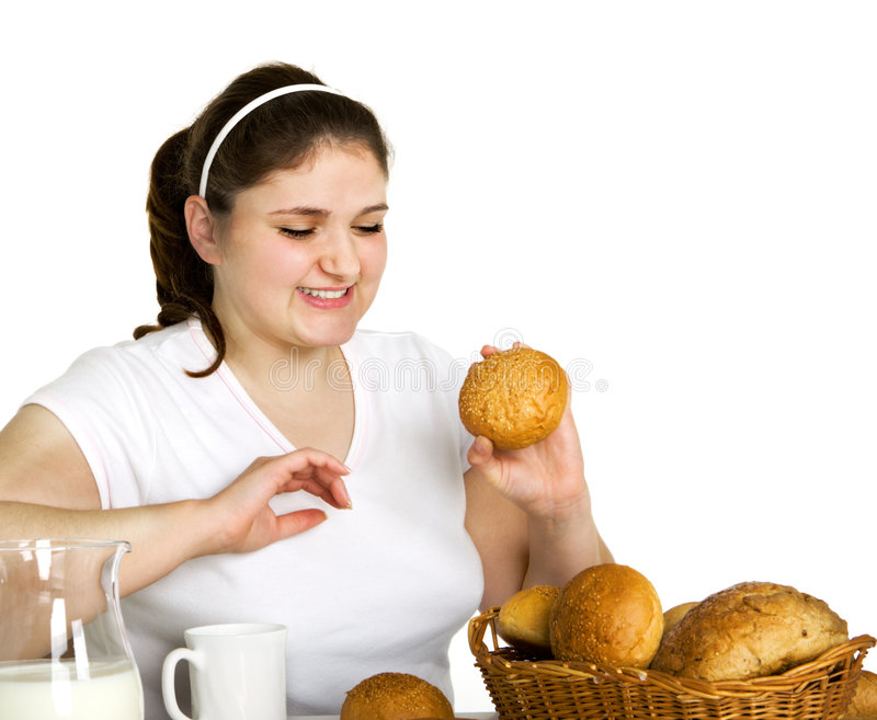 Download Girl likes to eat stock photo. Image of woman, bread, isolated - 7042396