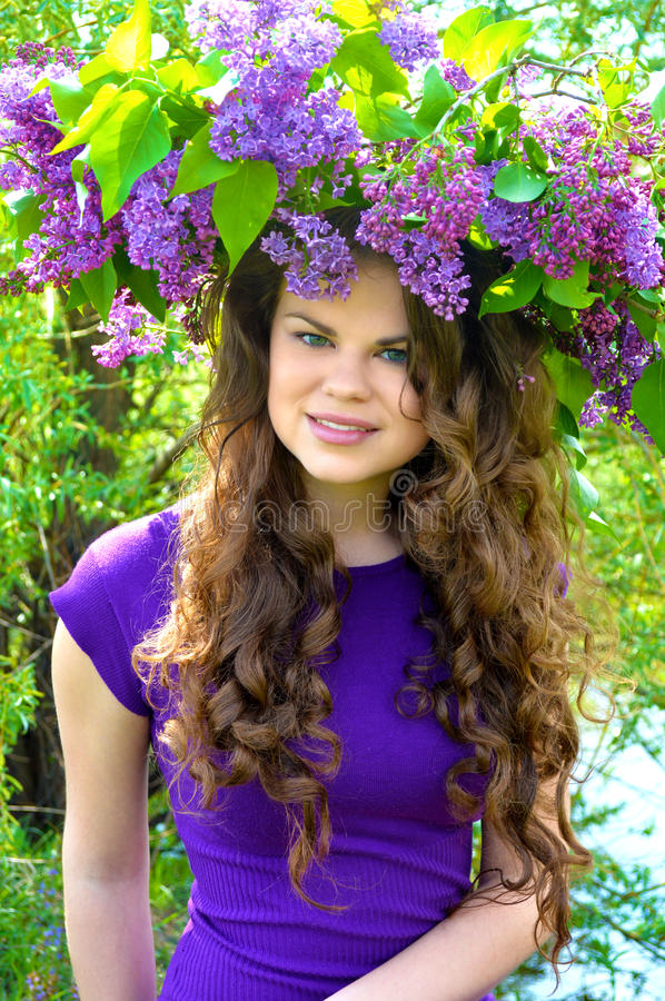 Girl with lilac flowers stock photography