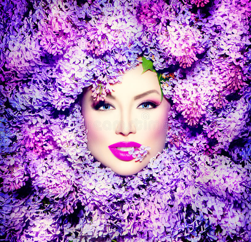 Girl with lilac flowers hairstyle royalty free stock photography