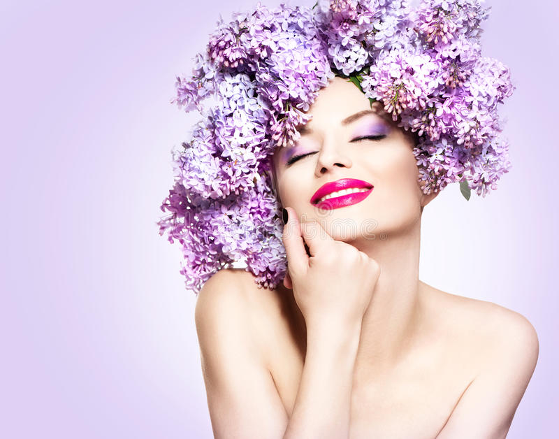 Girl with lilac flowers hairstyle. Beauty fashion model girl with lilac flowers hairstyle royalty free stock image