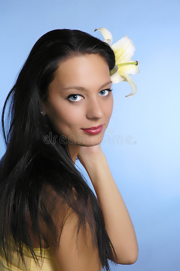 The girl with a lily in hair stock photos