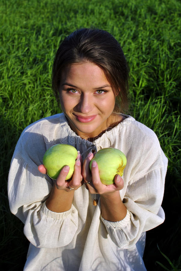 Download Girl In A Linen Shirt, Holding Apples Royalty Free Stock Photo - Image: 21022275