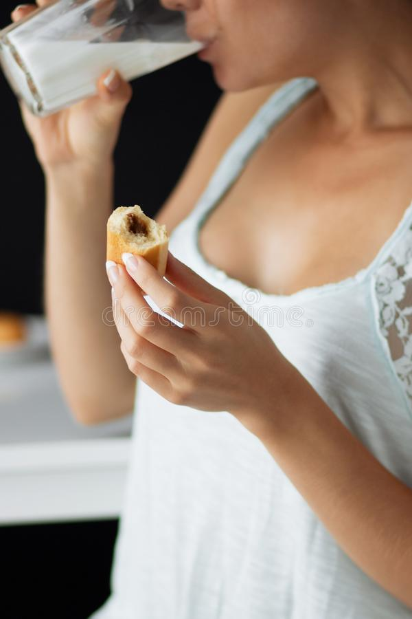 Girl in lingerie having Breakfast in the kitchen stock image