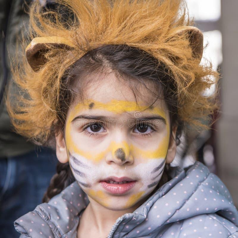 Girl with lion masquerade stock photos