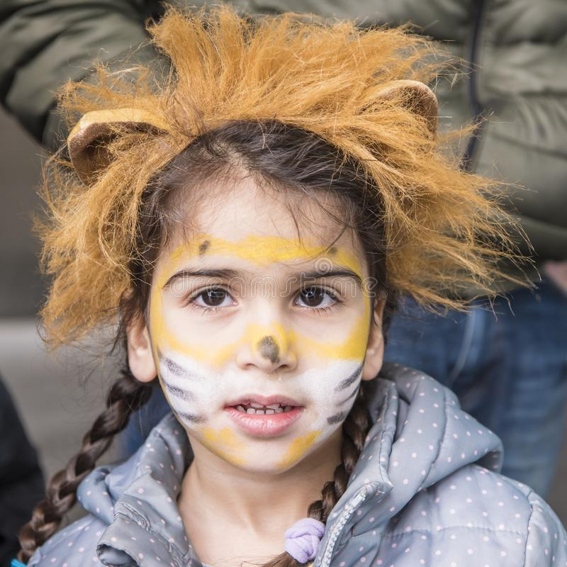 Girl with lion masquerade stock photography