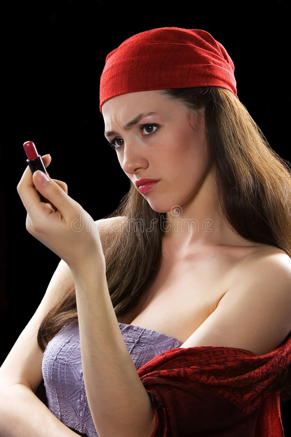 Girl with lipstick 1. White girl with lipstick on the black background royalty free stock photography