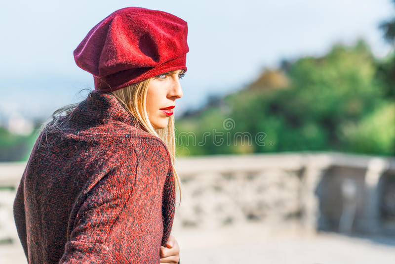 Girl with lipstick dressed in burgundy royalty free stock photo