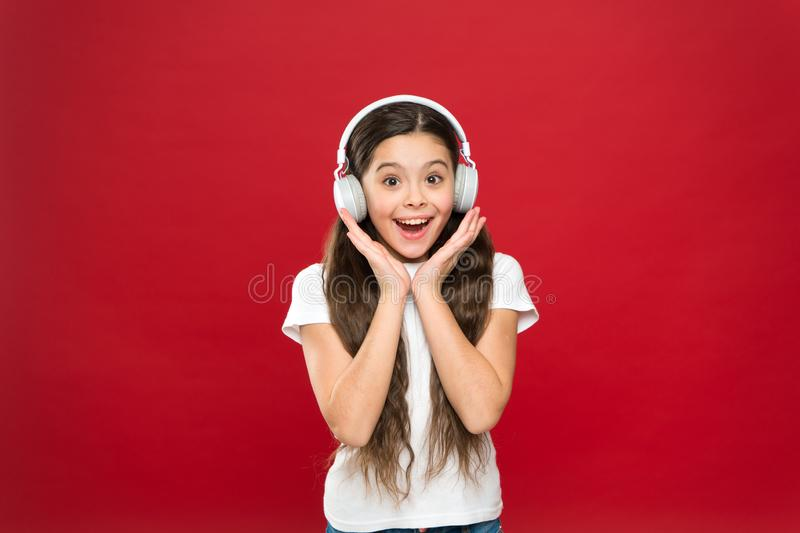 Girl listen music headphones on red background. Play list concept. Music taste. Music plays an important part lives. Teenagers. Powerful effect music teenagers royalty free stock photo