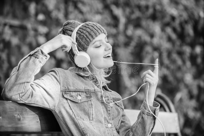 Girl listen music in park. Melody sound and mp3. Music fan concept. Headphones must have modern gadget. Enjoy powerful royalty free stock images