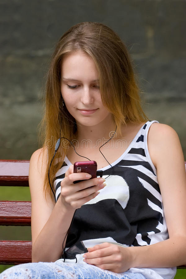 Download Girl is listening mp3 stock image. Image of portable - 20599539