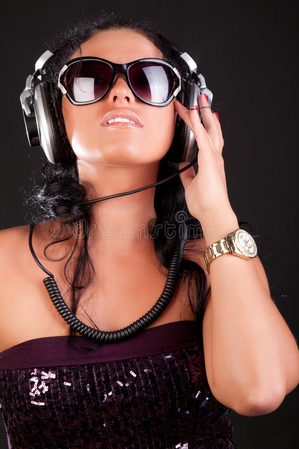 Girl is listening a music royalty free stock image