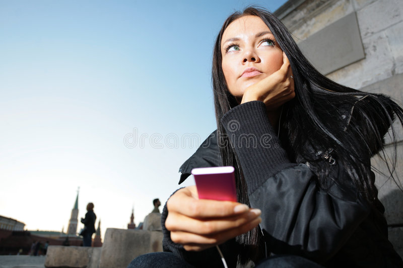 Girl listening music stock images