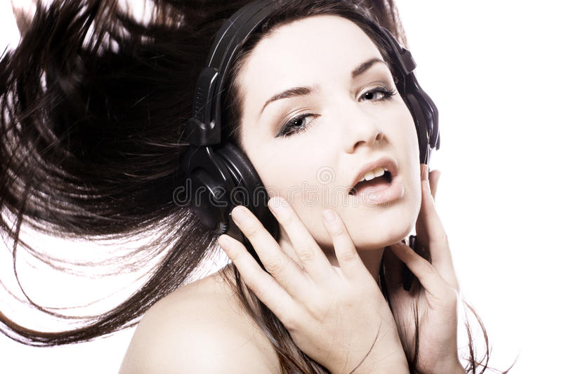 Girl listening to headphones royalty free stock images