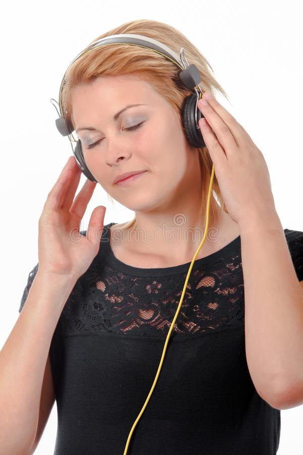 Girl listening to music. Attractive stock images