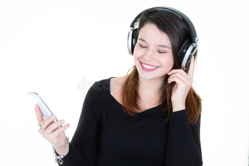 Girl listening to music with her smartphone stock photos