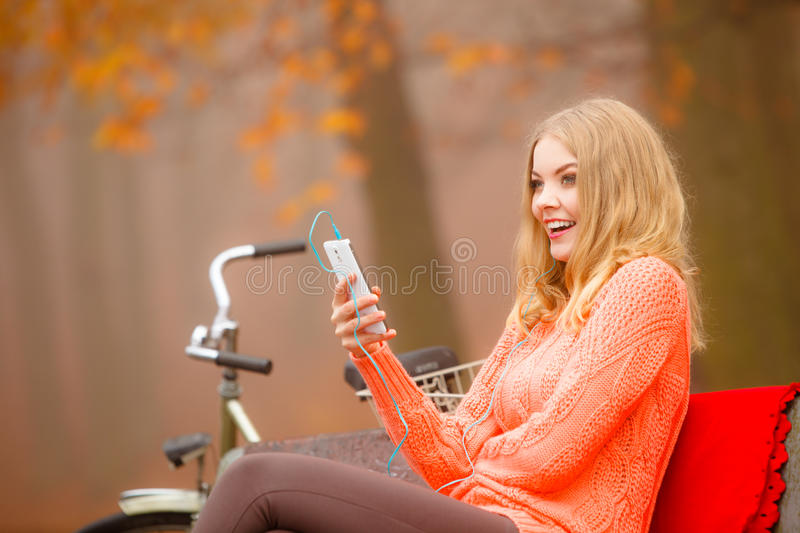 Girl listening to music mp3 relaxing. Technology, music and happiness concept. young woman or student girl with headphones listening to music mp3 relaxing or royalty free stock photography