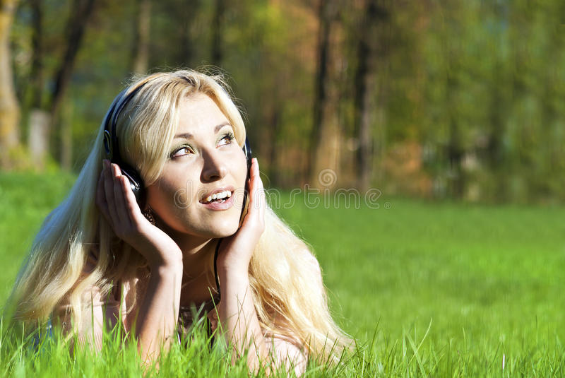 Download Girl Listening To Music In Nature Stock Image - Image: 24894531